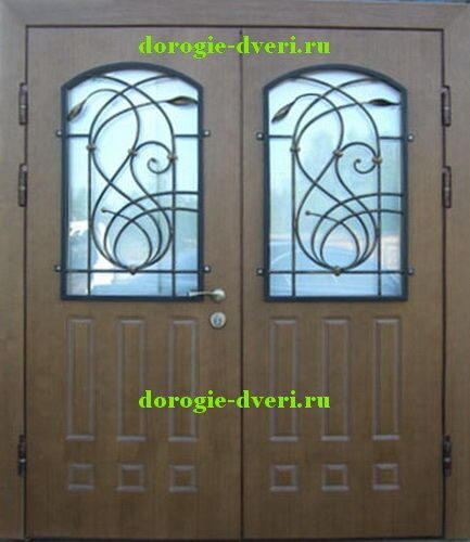двойные металлические двери с ковкой